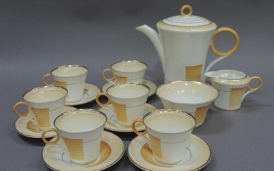 An Art Deco Shelley china coffee service, banded in amber on...