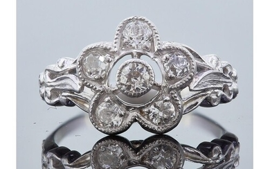 DIAMOND DAISY CLUSTER RING, of openwork design, set with a c...
