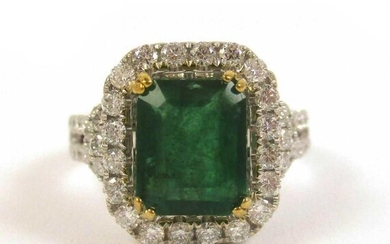 EMERALD, DIAMOND AND FOURTEEN KARAT GOLD RING. Th