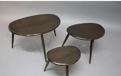 ERCOL 'PEBBLE' NEST OF TABLES a set of three dark elm tables...