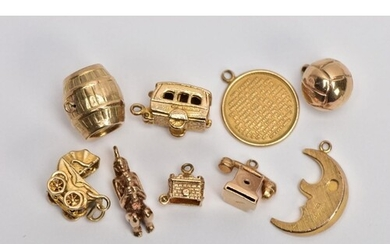 NINE 9CT GOLD CHARMS, to include a barrel, a hinged caravan,...