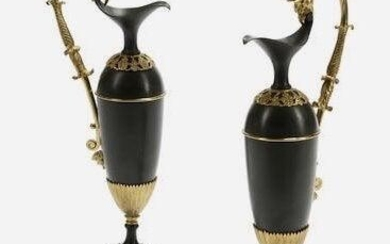 PAIR OF EMPIRE STYLE GILT AND PATINATED BRONZE EWERS