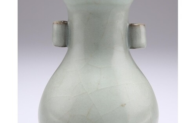 A CHINESE CELADON VASE, bottle shaped porcelain with twin ha...