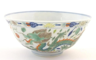 A Chinese bowl with dragon and flaming pearl detail