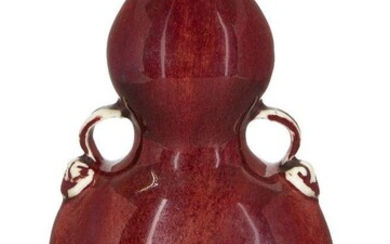 A Chinese monochrome porcelain copper-red double-gourd vase, huluping, 19th century, of flattened form with moulded loop handles, 18.3cm high