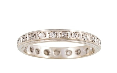 A DIAMOND FULL ETERNITY RING, set with circular stones in wh...