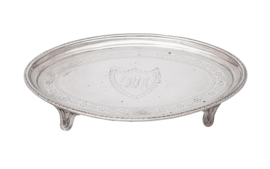 A George III silver shaped oval tea pot stand by Charles Aldridge
