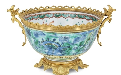 A Japanese Kutani bowl, Meiji period, mounted with later French gilt foot, rim and handles, decorated with watery flora and foliage to the exterior, fish and insects to the bowl interior, Kirin depicted in the well, signed Dai Nippon with illegible...