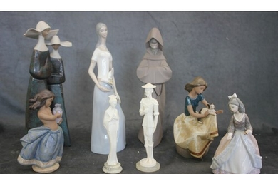 A Lladro figure of two nuns, three further figures of girls,...