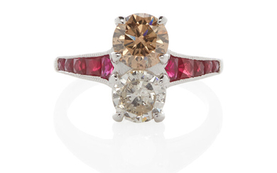 A PLATINUM TWO-STONE FANCY COLORED DIAMOND AND DIAMOND RING