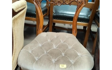 A Victorian walnut nursing chair with buttoned down overstuf...