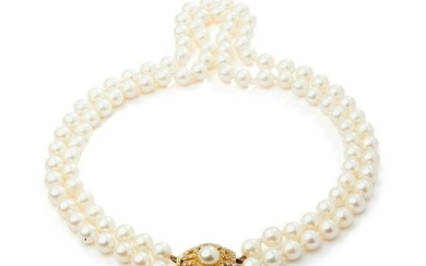 A cultured pearl and diamond necklace, by Leo De