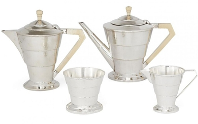 Amendment: Please note that this is a matched set and the hallmarks are as follows: teapot and milk jug London, c.1935, EV; sugar London, c.1934, EV; hot water pot Sheffield, c.1937, EV. A four-piece Art Deco silver tea service by Viners Ltd...