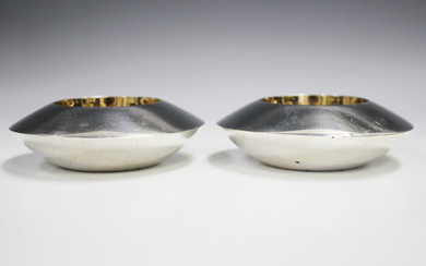 A pair of Elizabeth II silver circular salts, each of disc form with central gilt wells, London 1997
