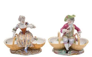 A pair of Meissen figural sweetmeat dishes and a similar pai...