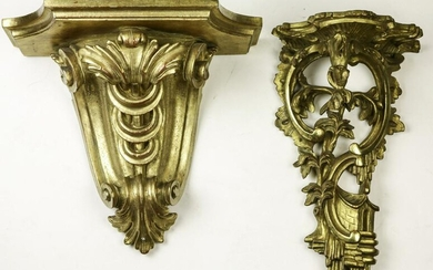 A pair of Rococo style Italian giltwood carved wall