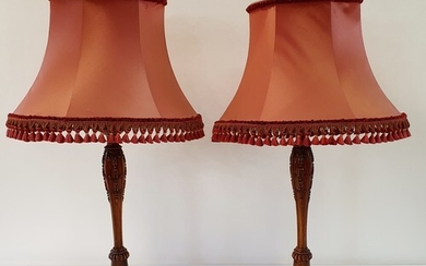 A pair of carved walnut lamp bases, 47 cm high