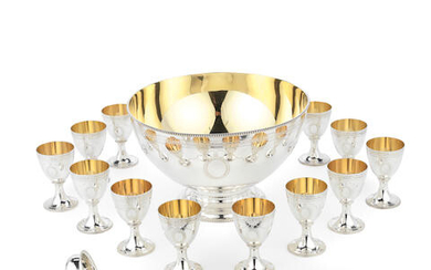 A silver punch bowl with ladle and a set of twelve goblets