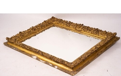 An ornate Victorian giltwood and gesso rectangular wall mirr...