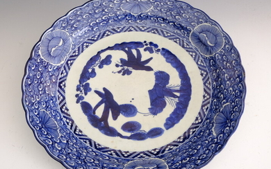 CHINESE BLUE AND WHITE PORCELAIN SCALLOPED ROUND CHARGER. Floral decoration...