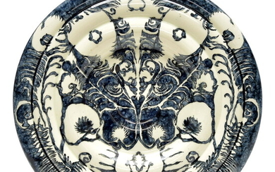 """Earthenware wall-plate with blue and white decoration """"Witte Pauweveer"""", painted..."""