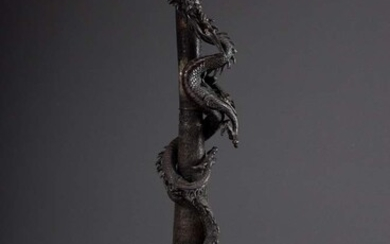 Japanese bronze candlestick with sculpted dragon on three legs with...