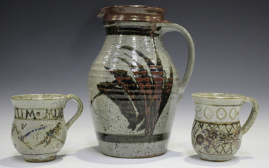 Two Elizabeth Roussel studio pottery mugs, both commemorating the millennium, height 9.3cm, together