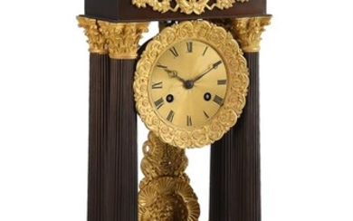 A FRENCH CHARLES X ORMOLU AND PATINATED BRONZE PORTICO MANTEL CLOCK