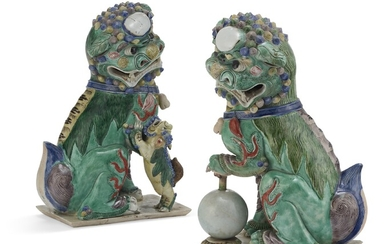 A PAIR OF CHINESE FAMILLE VERTE BISCUIT PORCELAIN BUDDHIST LIONS
