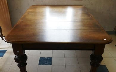 A Victorian mahogany extending dining table, with one additi...