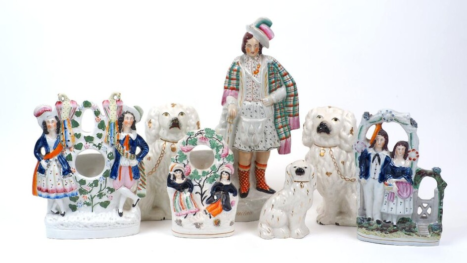 A group of seven Victorian Staffordshire figures, to include a large figure of William Wallace, 39cm high, two large spaniels, 22cm high, with a smaller spaniel, 14cm high, and three flat-back figure groups (7)