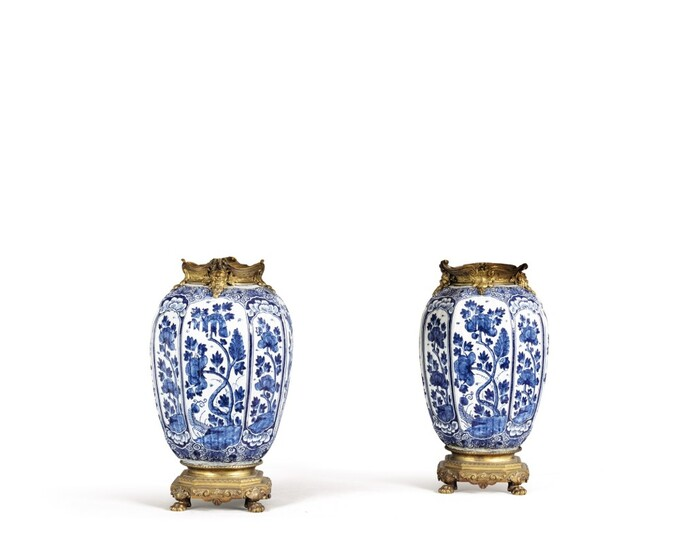 A pair of Delft earthenware and gilt-bronze mounted vases
