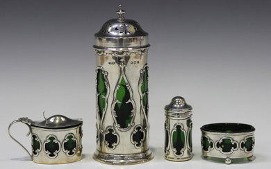 An Edwardian silver sugar caster of cylindrical form with pierced domed cover, the sides pierced wit