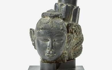 An Indian carved black stone head of a female