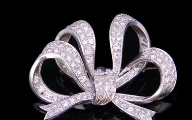 DIAMOND BOW BROOCH, of openwork knotted design, set with dia...
