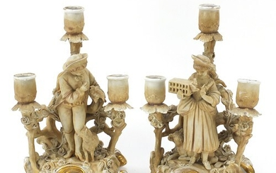 Pair of continental porcelain figural three branch candelabr...