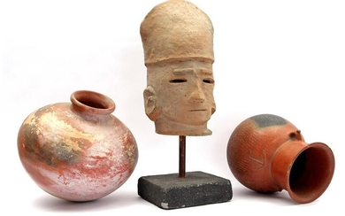Terracotta head on stand