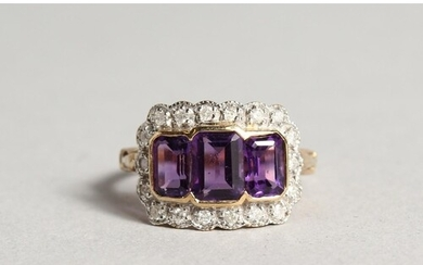 A 9CT GOLD EMERALD CUT AMETHYST AND DIAMOND RING