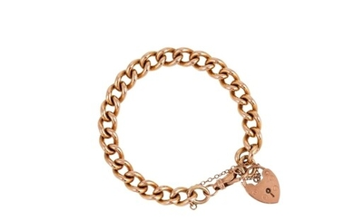 A 9CT YELLOW GOLD HEAVY CURB LINK BRACELET, with padlock, 40...