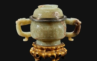 A Chinese pale celadon and brown jade censer and cover