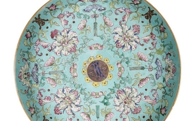 A Chinese porcelain 'sanduo' dish, 19th century, painted in famille rose enamels on a turquoise ground with lotus blooms and meandering leafy scrolls interspersed with bats and Buddhist chimes, all encircling a central shou character, the underside...