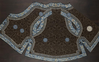 A Chinese silk embroidered ladies robe, late 19th century, decorated with Buddhist emblems and floral sprays on a brown ground with blue trim decorated with figures and floral sprays, 83cm long, in glazed frame