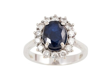 A DIAMOND AND SAPPHIRE CLUSTER RING, mounted in 18ct white g...