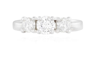 A DIAMOND THREE-STONE RING Composed of a central...