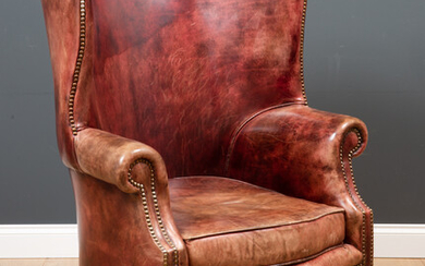 A George II style leather upholstered wing back armchair