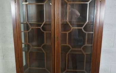 A George III style mahogany china cabinet on stand, 20th century reproduction, with two astragal