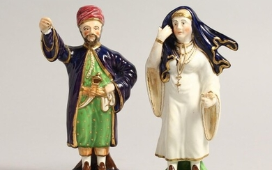 A SMALL PAIR OF FIGURES, TURKISH MAN AND LADY 5.5ins high....