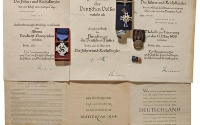 A collection of three medals with certificates - 1st