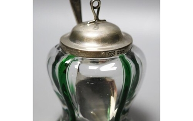 A late Victorian Art Nouveau silver mounted green and clear ...