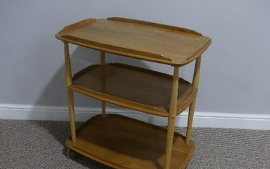 A mid 20thC Ercol three tier Trolley, Windsor 458, the round...